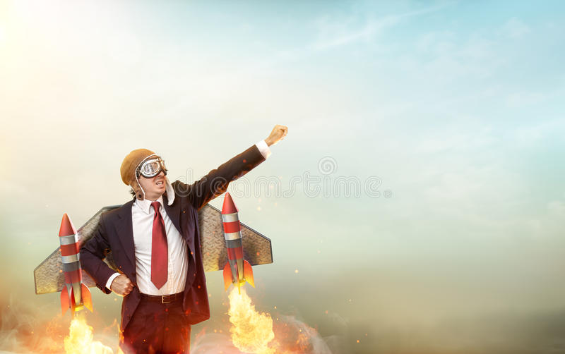 Homem de negócios With Jetpack On do aviador o seu para trás foto de stock