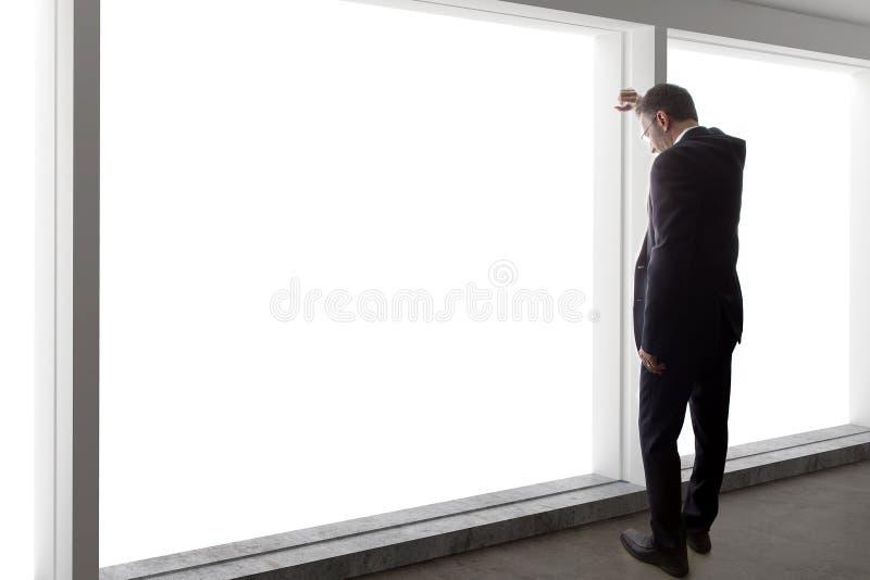 Homem de negócios Looking Stressed By a janela fotos de stock