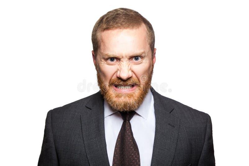 Homem de negócios louco irritado que olha a câmera fotos de stock royalty free