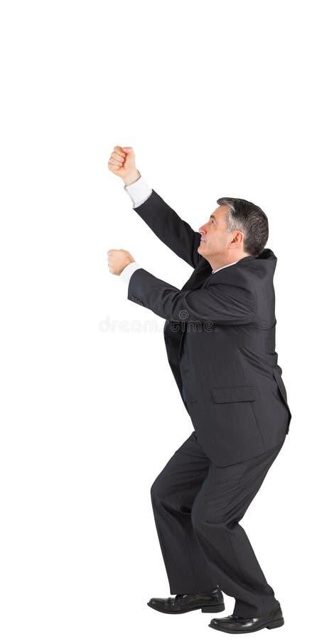 Homem de negócios maduro que puxa com mãos imagens de stock royalty free