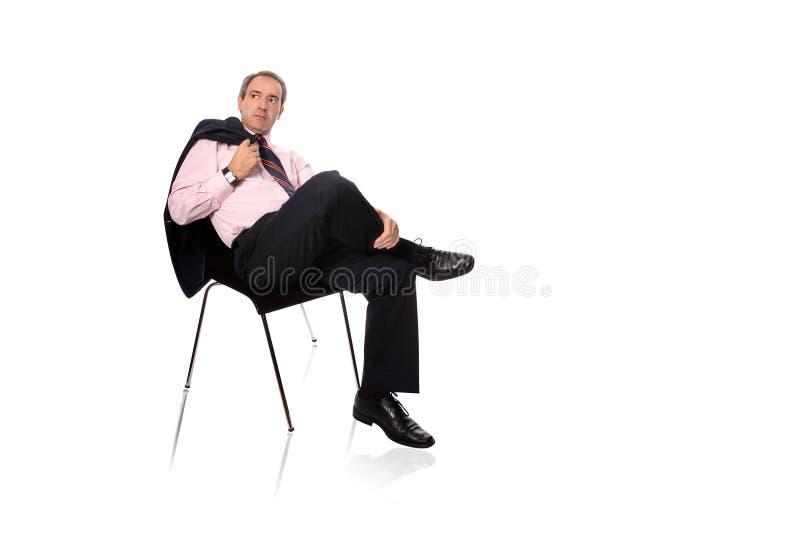Homem de negócios maduro que relaxa imagem de stock royalty free