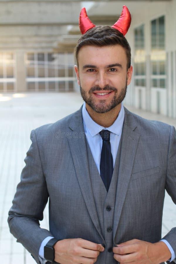 Homem de negócios mau com um olhar demoníaco 'sexy' foto de stock royalty free