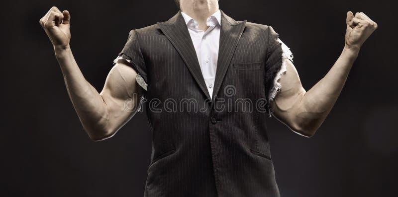 Homem de negócios muscular que consegue um sucesso da vida fotos de stock royalty free