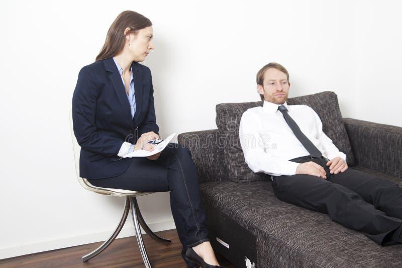 Homem de negócios na psicanálise fotos de stock royalty free