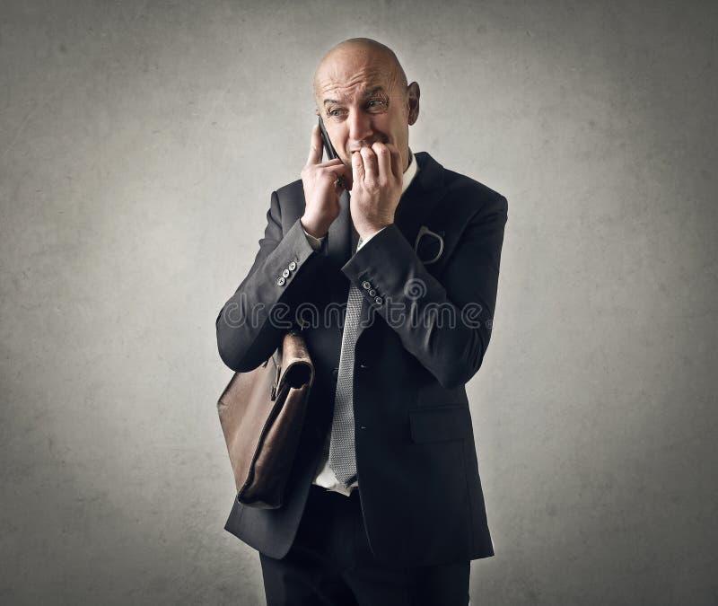 Homem de negócios nervoso fotografia de stock