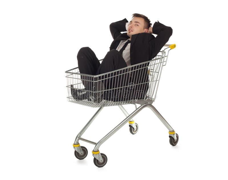 Homem de negócios no carro de compra fotos de stock