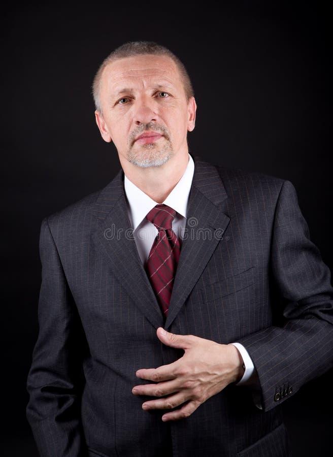 Homem de negócios no fundo preto foto de stock