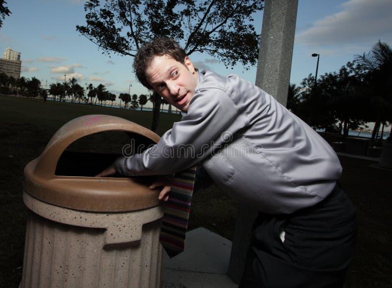 Homem de negócios no lixo imagens de stock