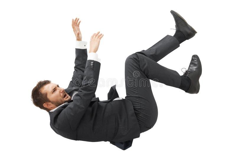 Homem de negócios no terno preto que cai para baixo imagem de stock royalty free