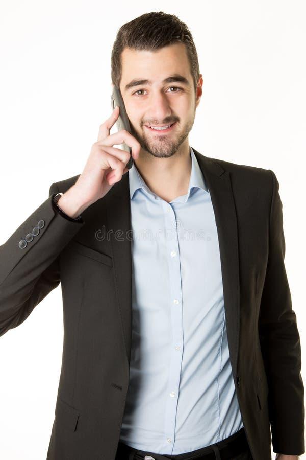 Homem de negócios no terno que fala no telefone no escritório imagem de stock royalty free
