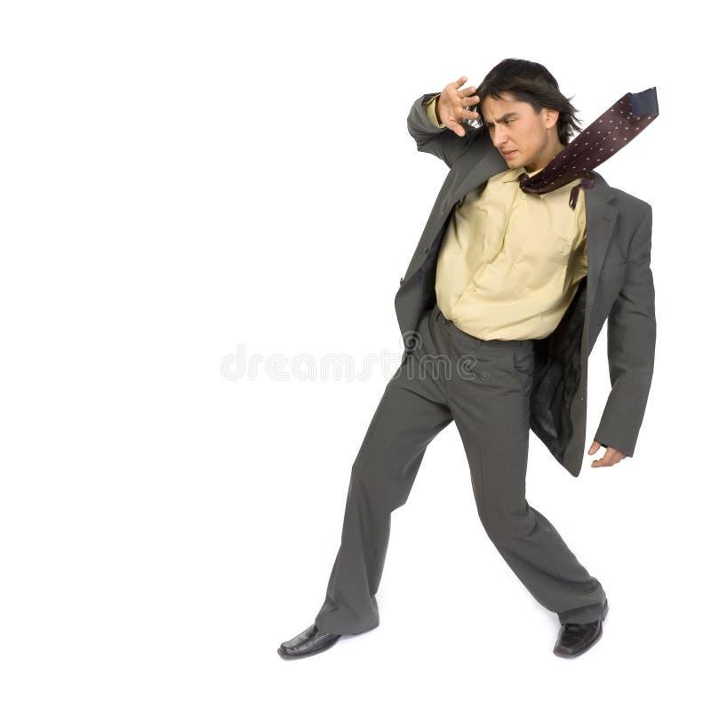 Homem de negócios no vento fotografia de stock