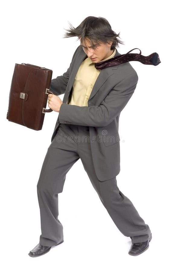 Homem de negócios no vento imagem de stock