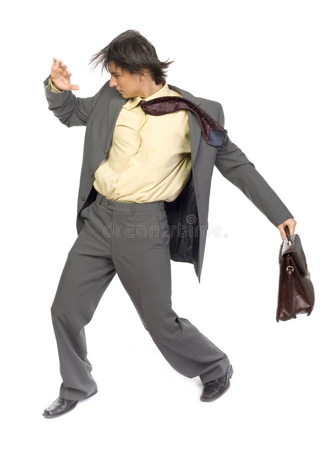 Homem de negócios no vento foto de stock
