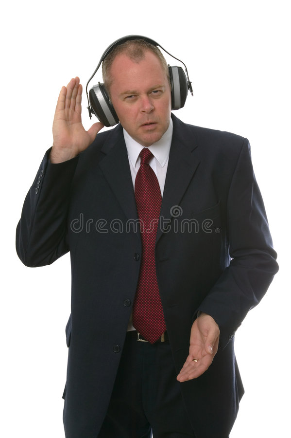 Homem de negócios nos fones de ouvido imagem de stock