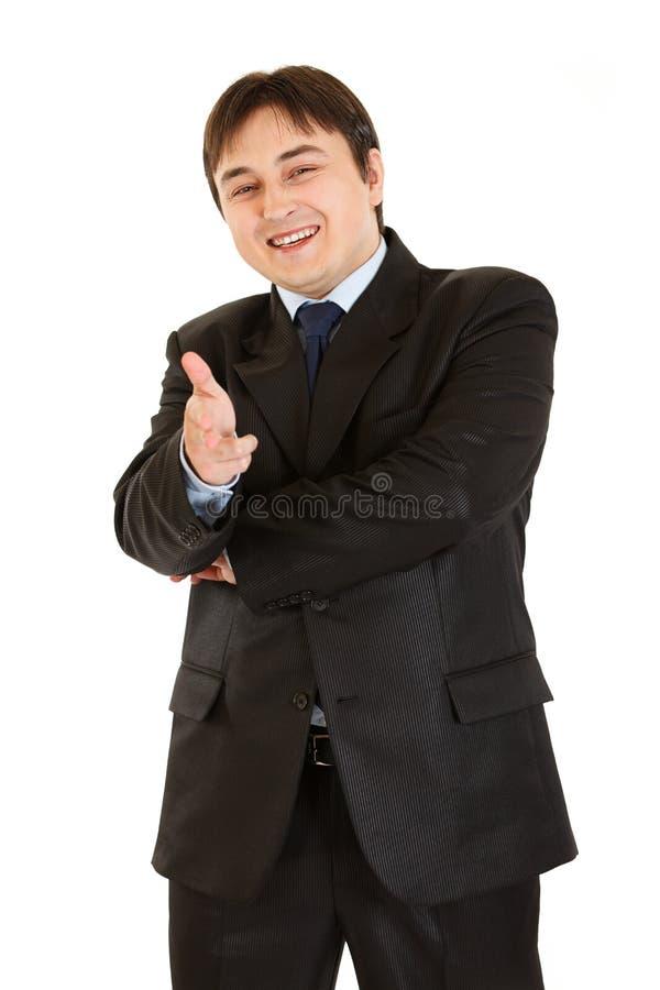 Homem de negócios novo alegre com mão dada forma injetor imagens de stock