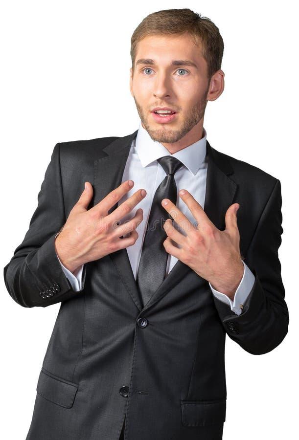 Homem de negócios novo assustado e surpreendido foto de stock