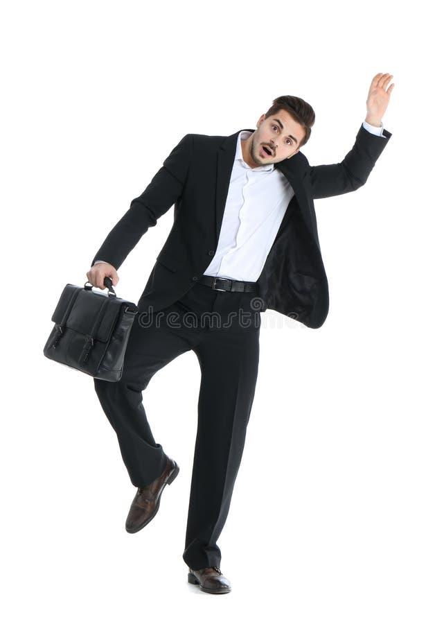 Homem de negócios novo atraído ao ímã fotografia de stock royalty free