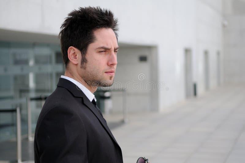 Homem de negócios novo atrativo fotos de stock royalty free