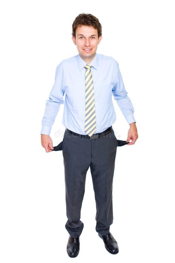 Homem de negócios novo com bolsos vazios, conceito fotos de stock royalty free