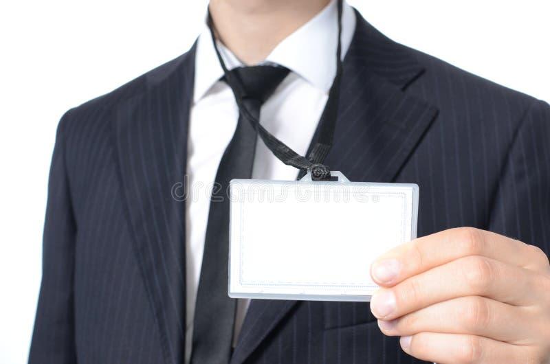 Homem de negócios novo com cartão de identidade fotografia de stock