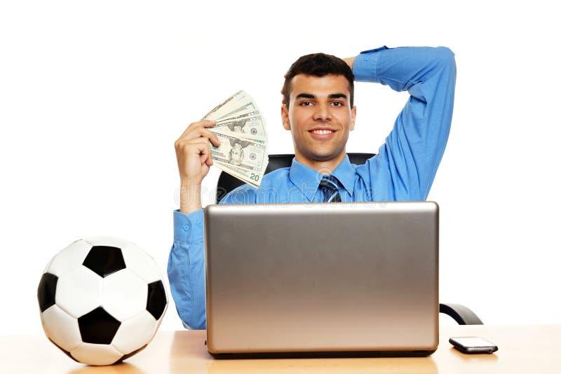 Homem de negócios novo com dinheiro imagens de stock