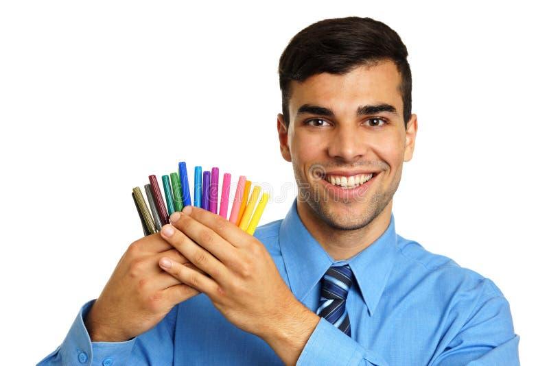 Homem de negócios novo com marcadores fotografia de stock