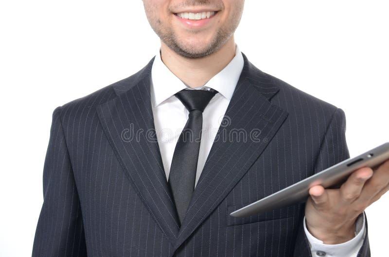 Homem de negócios novo com tabuleta imagem de stock royalty free