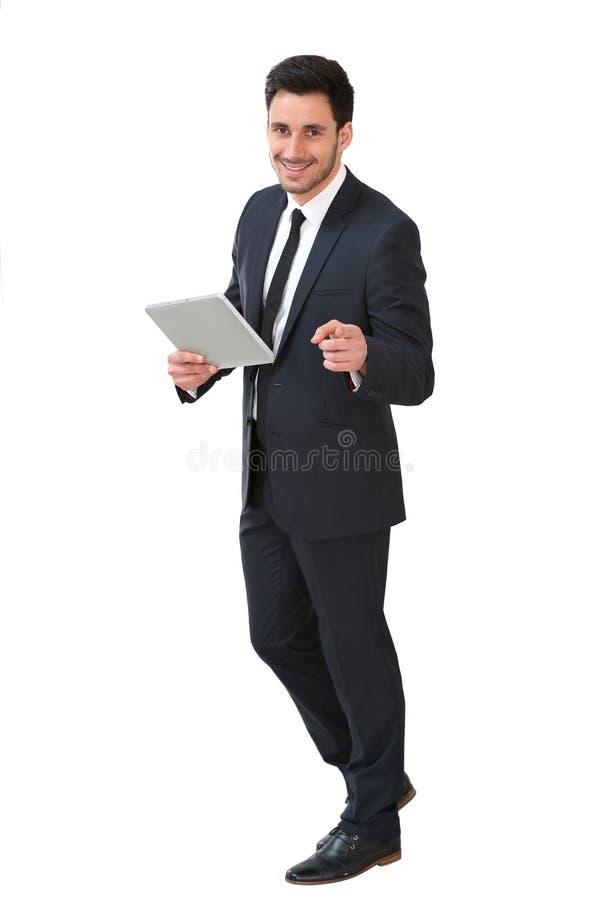 Homem de negócios novo com a tabuleta isolada foto de stock royalty free