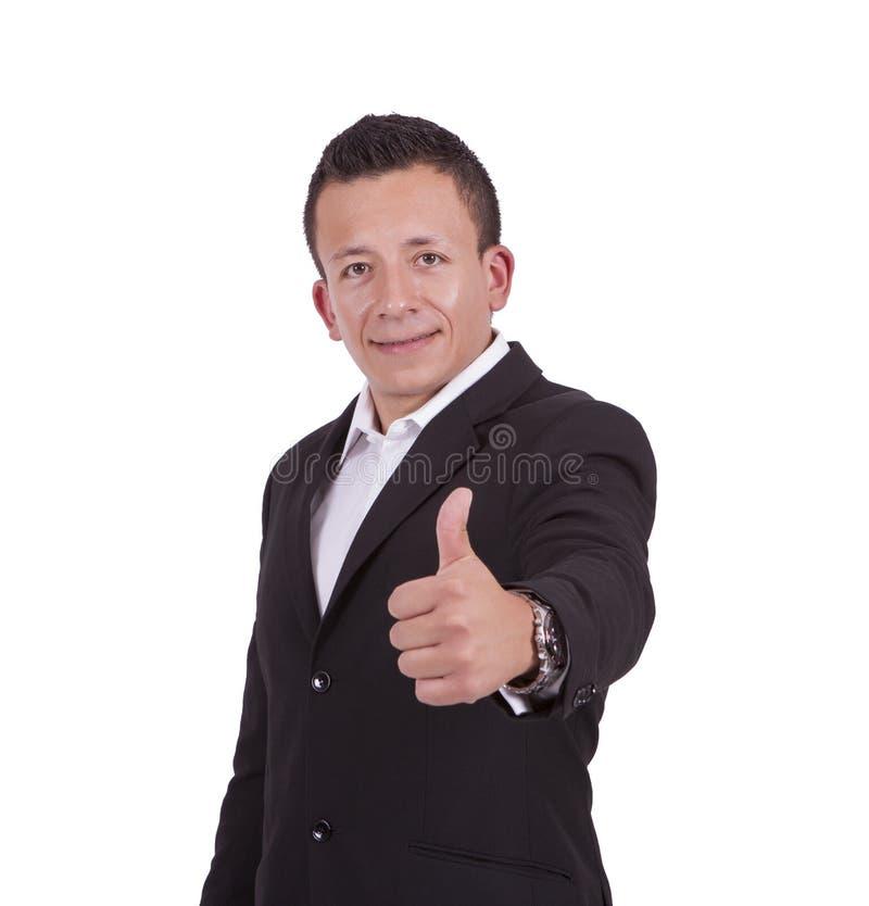 Homem de negócios novo de sorriso que gesticula os polegares acima imagem de stock