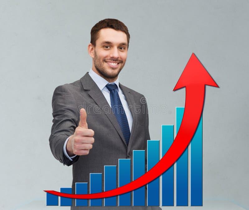 Homem de negócios novo de sorriso que mostra os polegares acima foto de stock