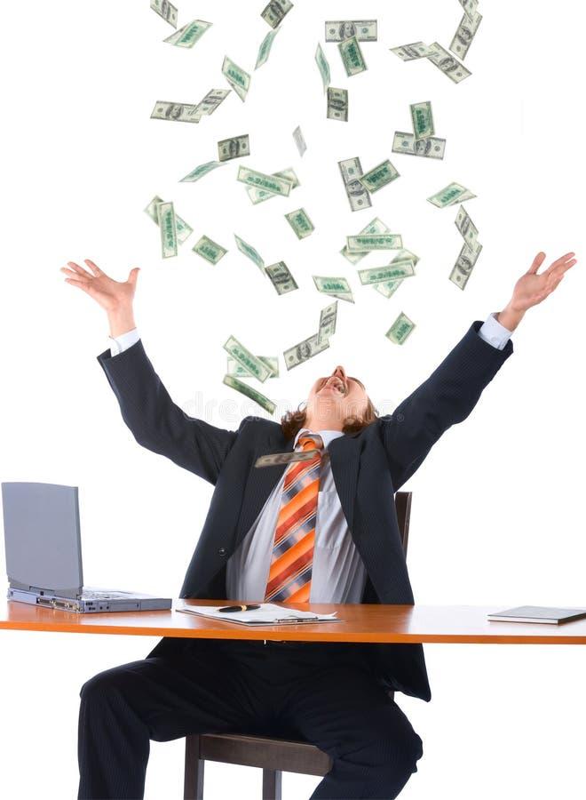 Homem de negócios novo e dinheiro de queda imagem de stock