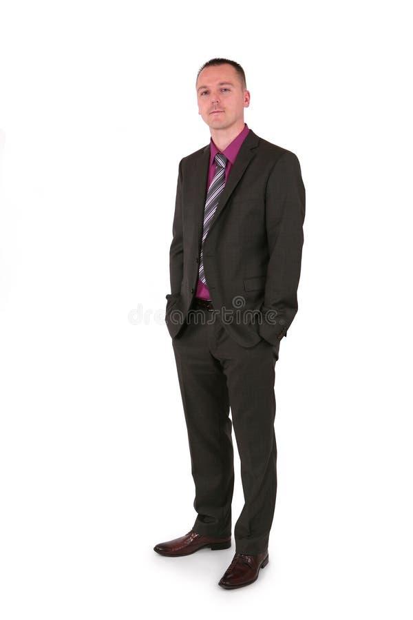 Homem de negócios novo em um terno imagens de stock