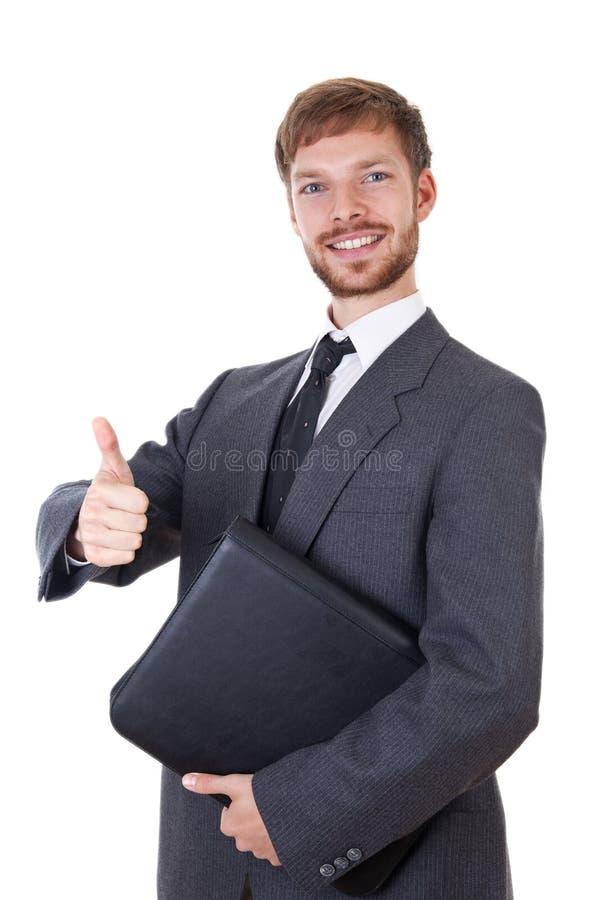 Homem de negócios novo esperto com polegar acima imagem de stock
