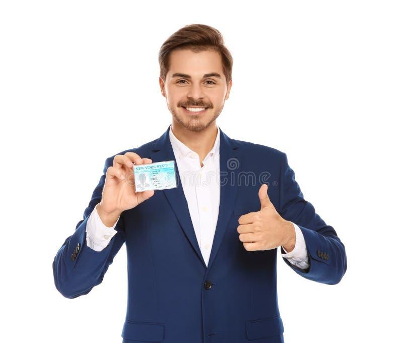 Homem de negócios novo feliz com carteira de habilitação imagem de stock