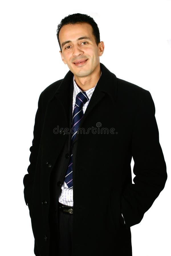 Homem de negócios novo no revestimento fotografia de stock royalty free