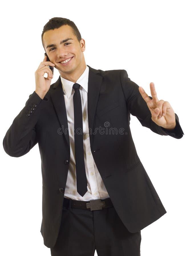 Homem de negócios novo no telefone foto de stock