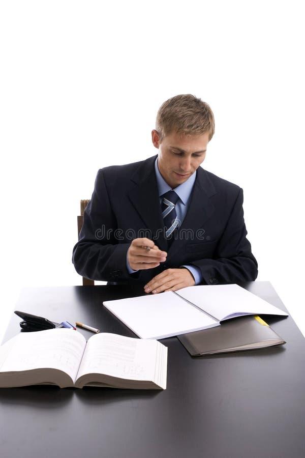 Homem de negócios novo no trabalho imagem de stock