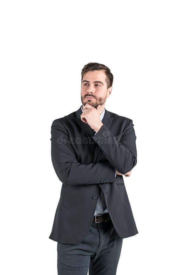 Homem de negócios novo pensativo fotografia de stock