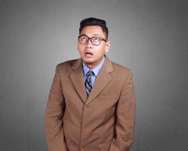 Homem de negócios novo Pensive, expressão confusa imagens de stock royalty free