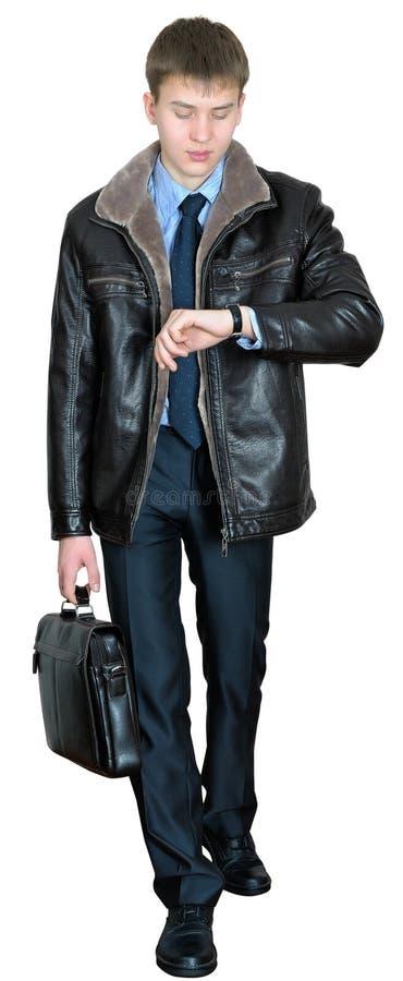 Homem de negócios novo que apressa-se a uma reunião de negócios imagens de stock