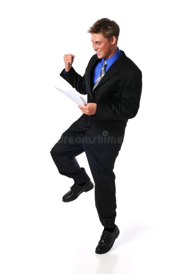 Homem de negócios novo que mostra o excitamento foto de stock