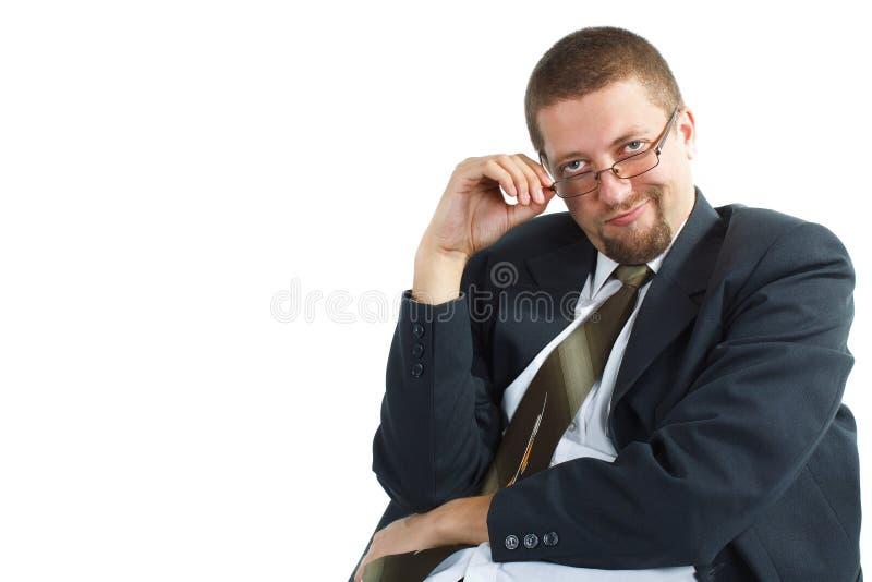 Homem de negócios novo que olha bossy imagens de stock royalty free