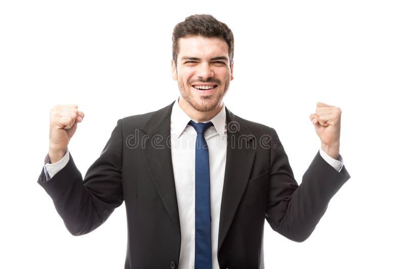 Homem de negócios novo que olha entusiasmado fotografia de stock