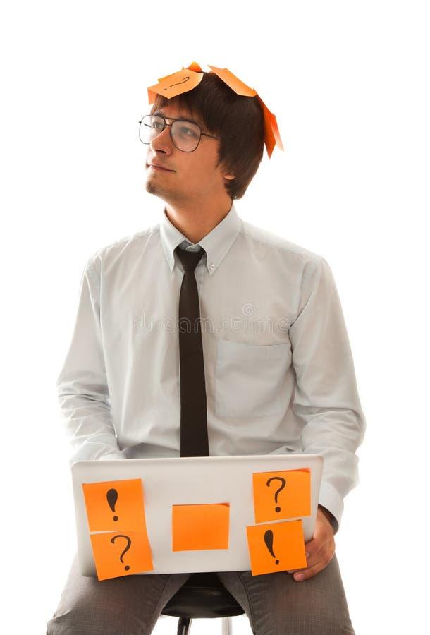 Homem de negócios novo que pensa sobre o futuro imagem de stock