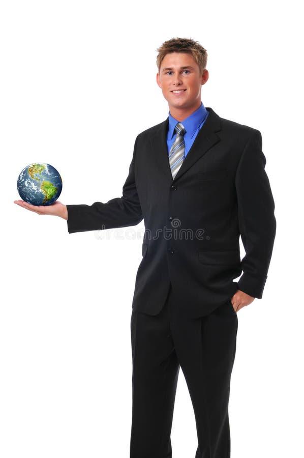 Homem de negócios novo que prende a terra imagem de stock
