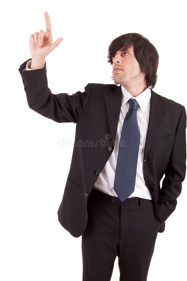 Homem de negócios novo que pressiona a chave fotos de stock