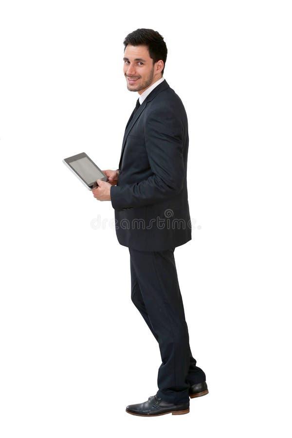 Homem de negócios novo que usa a tabuleta foto de stock royalty free