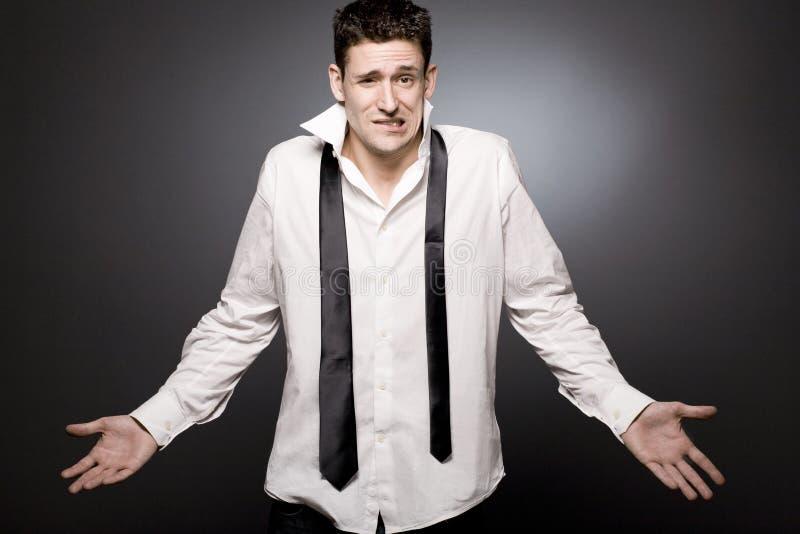 Homem de negócios novo surpreendido na camisa branca. fotos de stock