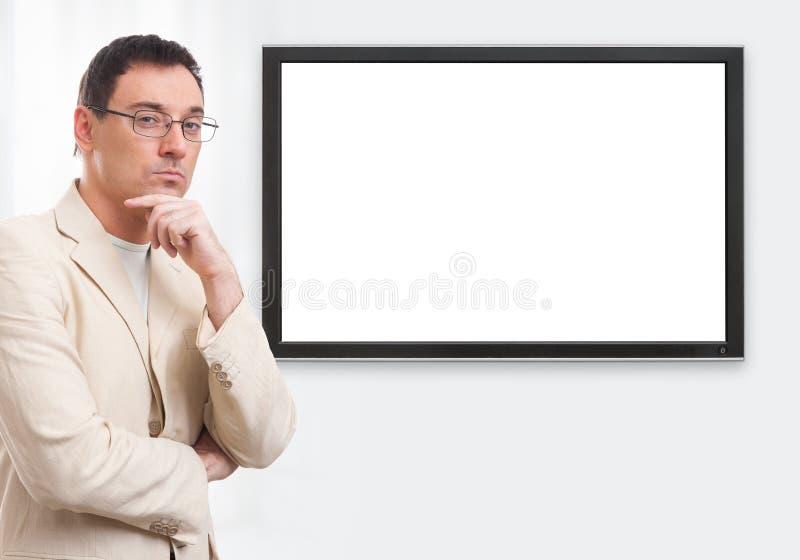 Homem de negócios ocasional considerável e tela digital imagens de stock royalty free