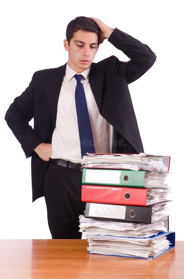 Homem de negócios ocupado sob o esforço de trabalho foto de stock